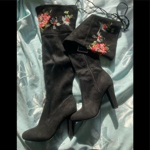 Black over-the-knee boots with floral embroidery
